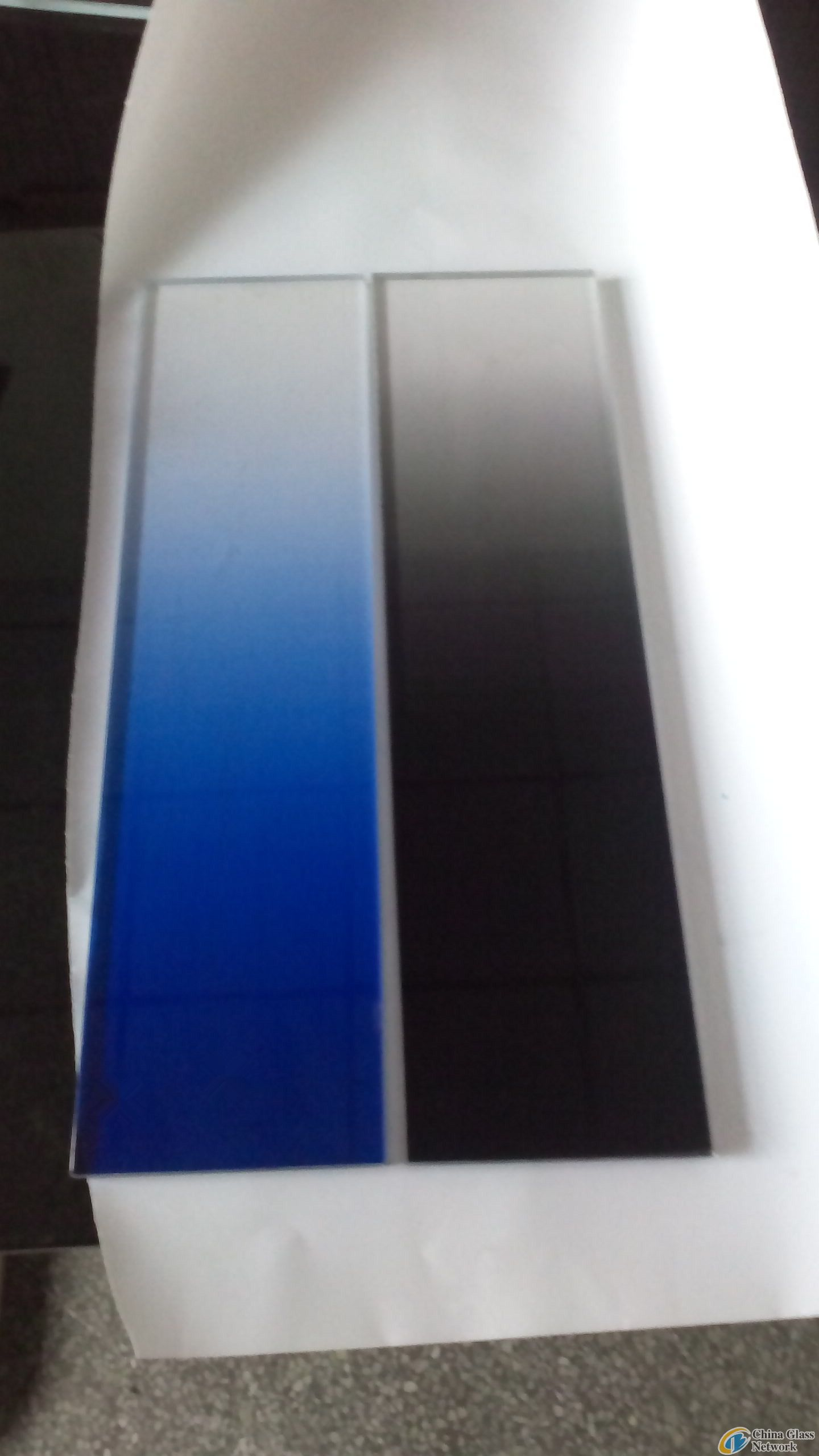 Laminated gradient change glass