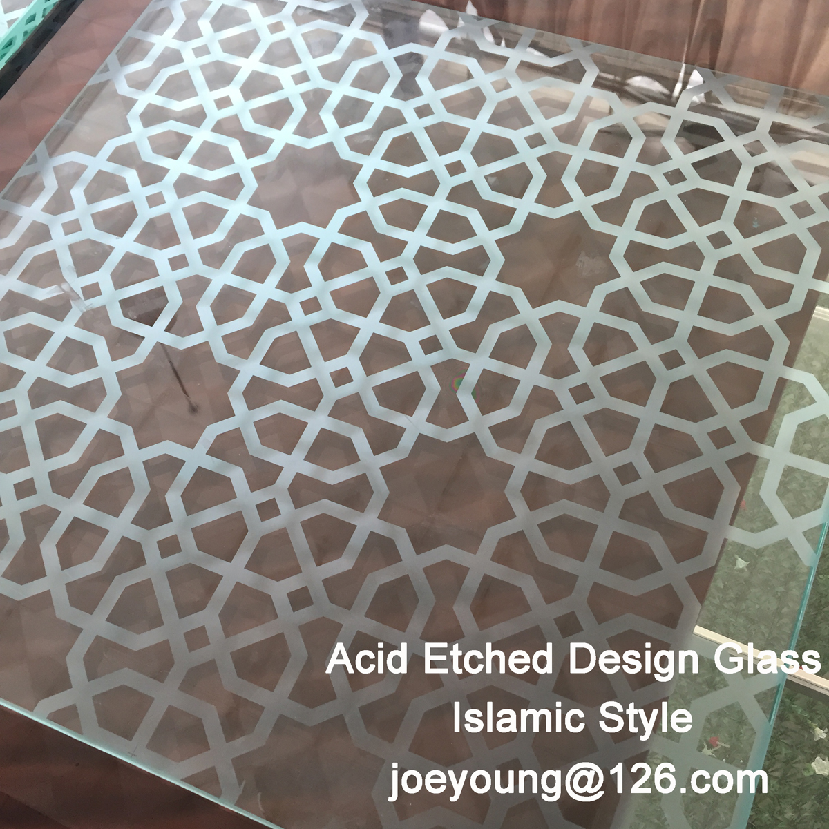 Acid etched glass with design